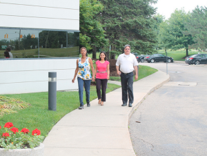 Deborah Rene, Jennifer Agrawal and Marvin Stepnak walk around the Essex Centre building in Southfield, MI to rack-up steps.