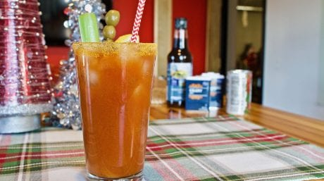 A bloody mary drink sits on a kitchen table