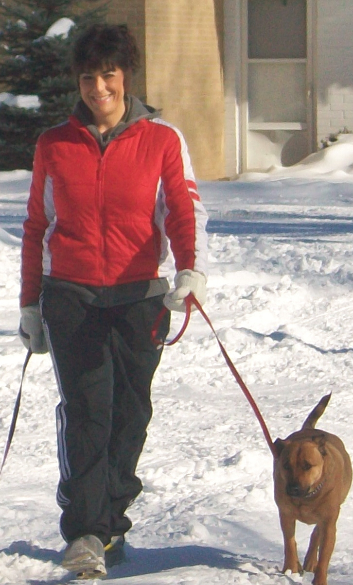 Jodi Davis walks with her dog