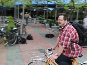 Brian Ambrozy, community manager for Shinola, takes a spin around the BCBSM courtyard.