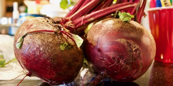 Two beets on a counter top
