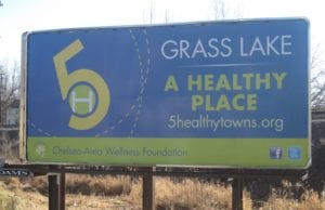 City sign for Grass Lake's sponsorship by 5 Healthy Towns Foundation.