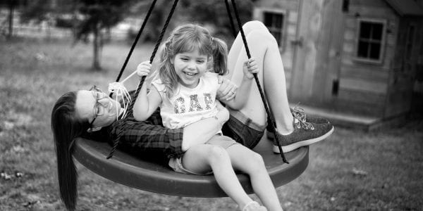 mom and daughter swinging