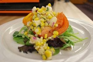 Image of grilled tomato with corn salsa
