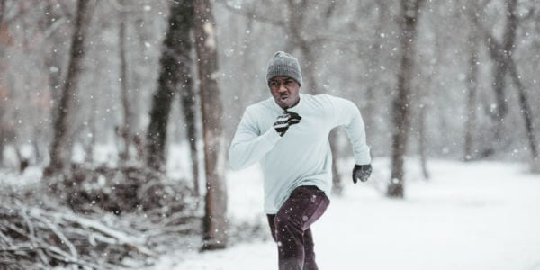 Man running through the snow.