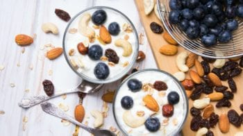 Healthy dessert with yogurt, nuts, oats and blueberries