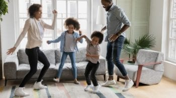 Active family dancing in the living room